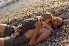 Father with a young son on beach. With sunset Royalty Free Stock Photography