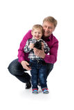 Father and young son with a camera in his hands. Royalty Free Stock Photography