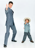 Father with a young son, dressed in a suit Royalty Free Stock Photography
