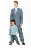 Father with a young son, dressed in a suit Stock Photography