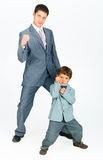 Father with a young son, dressed in a suit Stock Photo