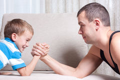 Father and young son are fighting Royalty Free Stock Photo
