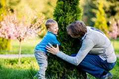 A family playing hide and seek. Father and young son playing hide and seek Royalty Free Stock Photography