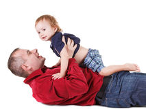 Father and young son playing, isolated over a white Royalty Free Stock Photo
