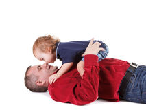 Father and young son playing, isolated over a white Royalty Free Stock Photos