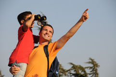Fathere and son. Father and son look peaks  mountain with binoculars in trekking day Royalty Free Stock Photos