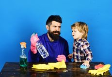 Fatherhood concept. Guy with beard and mustache holds spray. stock photos