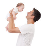 Fatherhood is great!. Happy young man holding a smiling 4-5 months old baby, isolated on white Royalty Free Stock Images