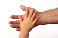 Fatherly love. Father and child bonding - two hands touching Royalty Free Stock Image