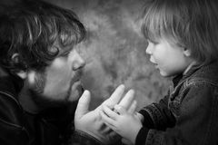 Fathers Advice. Father looking at son admiringly royalty free stock photography