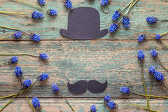 Fathers day background with cardboard hat and mustache and blue Royalty Free Stock Photography
