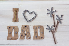 Fathers day background with cardboard letters and flower of nuts. And wrenches. Happy fathers day concept royalty free stock photo