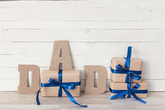 Fathers day background with cardboard letters and  gift boxes. H Stock Images