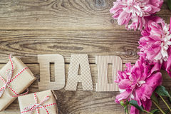 Fathers day background with cardboard letters, purple peonies a stock images