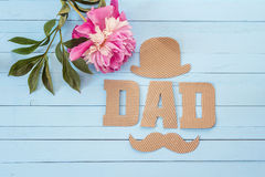 Fathers day background with cardboard letters and purple peony o royalty free stock images