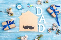 Fathers Day background with home symbol and gift boxes on blue w Royalty Free Stock Photo