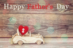 Fathers day background with toy car with a heart on a background. Of old boards. Happy fathers day concept royalty free stock images