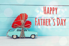 Fathers Day Background With Miniature Blue Toy Car Carrying A He Royalty Free Stock Images