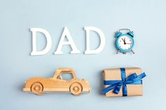 Fathers day background with wooden toy car, gift box, alarm cloc Royalty Free Stock Photos