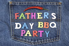 Fathers Day BBQ Party Wood Sign On Blue Jeans Pocket Stock Image