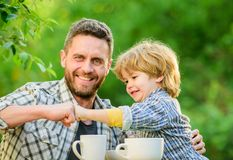 Fathers day. Best friends. Father and son having fun. Feeding son natural foods. Healthy food. Father and boy drink tea royalty free stock images