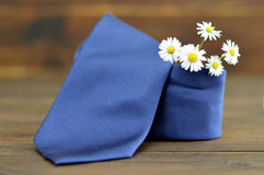 Fathers Day card: Blue tie and spring flowers Stock Photo