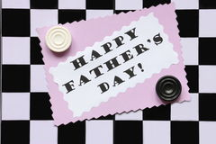 Fathers Day Card on Chessboard - Stock Photo. Fathers Day Card with Happy Fathers Day text and draughts on chessboard background Royalty Free Stock Photography