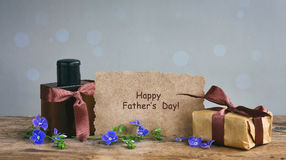 Fathers day card, gift box with brown ribbon, perfume bottle, pa royalty free stock images