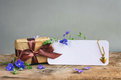 Fathers day card, gift box with brown ribbon Royalty Free Stock Photography