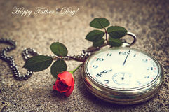 Fathers Day card: Old pocket watch and a rose Stock Images