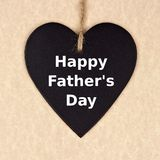 Fathers Day chalkboard heart over brown paper Stock Images