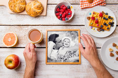 Fathers day composition. Black-and-white photo and breakfast mea Stock Image