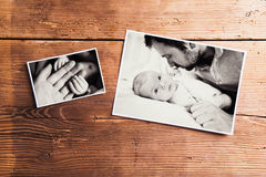 Fathers day composition. Black-and-white pictures, studio shot. Fathers day composition. Black-and-white family pictures. Studio shot on wooden background stock photos
