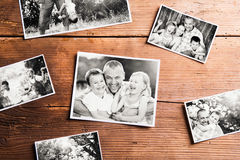 Fathers day composition. Black-and-white pictures, studio shot. Fathers day composition. Various black-and-white family pictures. Studio shot on wooden stock photo