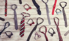 Fathers day composition. Of colorful ties and bow ties laid on wooden floor backround Royalty Free Stock Photo