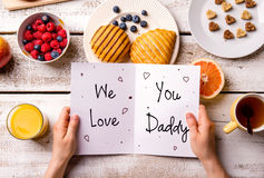 Fathers day composition. Greeting card and breakfast meal. Stock Photo