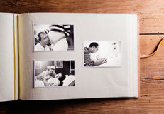 Fathers day composition. Photo album, black-and-white pictures. Studio shot on wooden background Royalty Free Stock Image