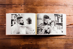 Fathers day composition. Photo album, black-and-white pictures. Studio shot on wooden background Royalty Free Stock Photos