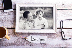 Fathers day composition. Picture of father with son in frame Stock Image