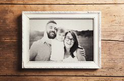 Fathers day composition. Picture frame with a black and white photo. Studio shot on wooden background stock photo