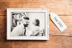 Fathers day composition. Picture frame. Wooden background. Stock Photos