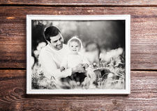 Fathers day composition. Picture frame. Wooden background. Royalty Free Stock Photography