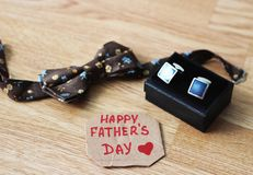 Greeting card with Father`s Day. View from above. Fathers day composition on wooden desk backround. royalty free stock images