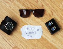 Greeting card with Father`s Day. View from above. Fathers day composition on wooden desk backround. royalty free stock image