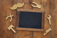 Fathers day composition with wooden shape tools and blackboard Royalty Free Stock Photography