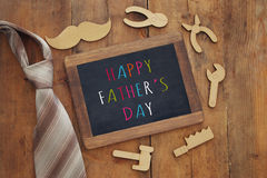 Fathers day composition with wooden shape tools and blackboard Stock Images