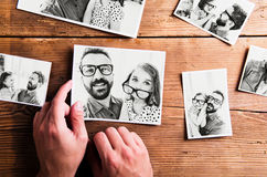 Fathers day concept. Black-and-white pictures, studio shot. Fathers day concept. Hands of unrecognizable men holding black-and-white photos of father and royalty free stock photos