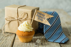 Fathers day concept - cupcake, tie, present Royalty Free Stock Photos