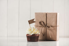 Fathers day concept. Delicious creative cupcake and gift box on Royalty Free Stock Images