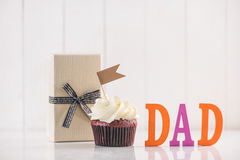 Fathers day concept. Delicious creative cupcake and gift box on Stock Photos